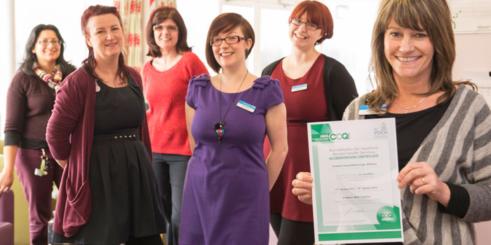Photo showing Cotswold House staff with a certificate.