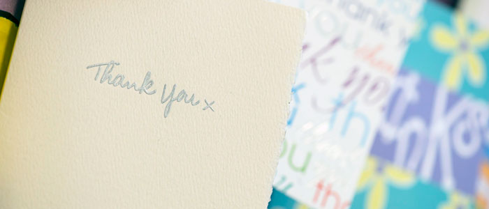 Photo showing cards and letters sent to staff by patients after treatment.