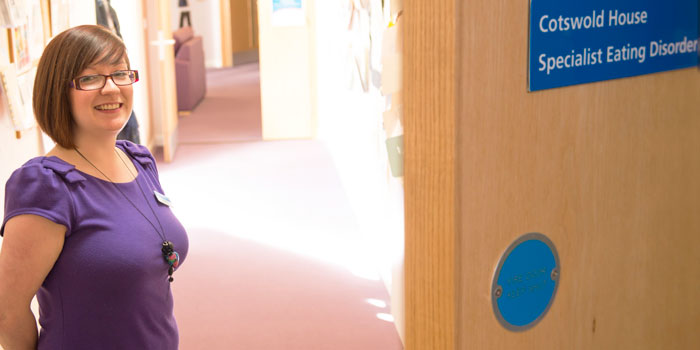 Photo showing member of staff welcoming patients to Cotswold House.