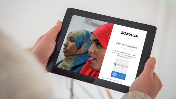 App screenshot showing two girls in colourful headscarves and text about Somalia