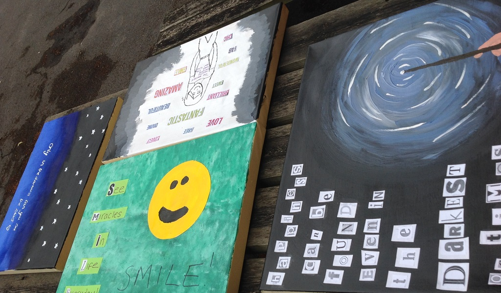 smiley face and text paintings