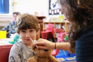 Young boy receiving nasal flu vaccine