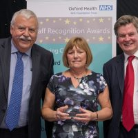 Picture of Lynda Coles with Chief Executive Stuart Bell CBE and Chairman Martin Howell