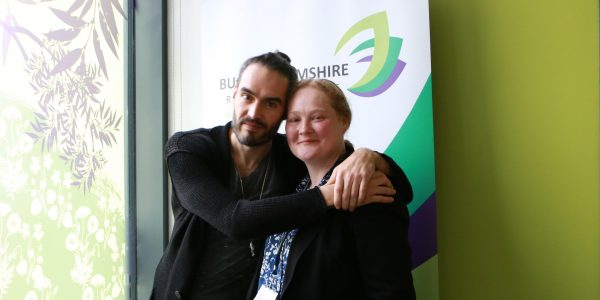 Russell Brand and Oxford Health staff member at launch.