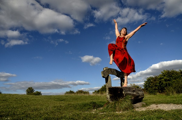 Older woman dancing outdoors