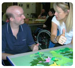 Picture showing two people using Makaton signing