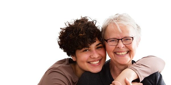 Photo of a carer embracing a service user.