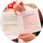 Photo of a member of staff highlighting text in a patient leaflet.