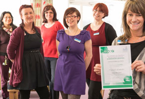 Photo of a team with certificate for new qualification.