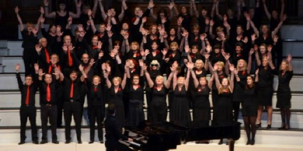 Group of people singing in a choir