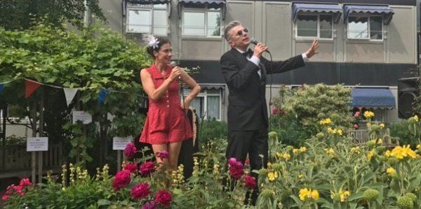 singers perform amidst flowers