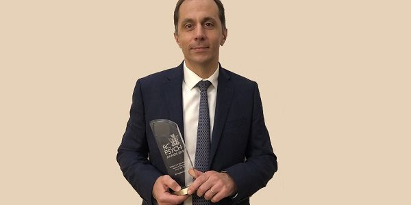 man holding award