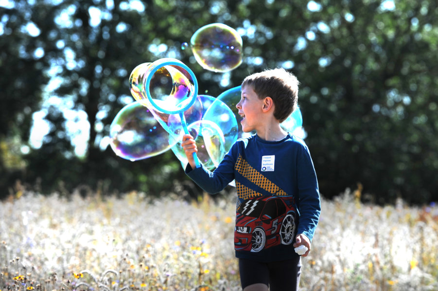 The Oxford Health Charity's Healthfest 2019 at The Warneford Hospital, Oxford. Six-year-old Norman having fun with bubbles in Warneford Meadow.