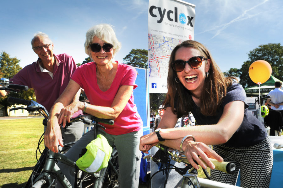 The Oxford Health Charity's Healthfest 2019 at The Warneford Hospital, Oxford.L to R, James and Kathryn McNicoll with Becci Curtis on the Cyclox stand.