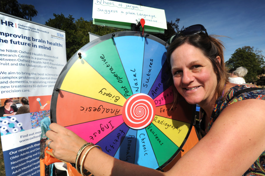 "The Oxford Health Charity's Healthfest 2019 at The Warneford Hospital, Oxford. Patient and public involvement manager (research), Claire Murray, with her ""Wheel of Jargon"" for people to spin to land on a jargon word which they could suggest a layman's term for."