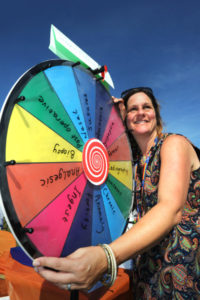 """The Oxford Health Charity's Healthfest 2019 at The Warneford Hospital, Oxford.Patient and public involvement manager (research), Claire Murray, with her """"Wheel of Jargon"""" for people to spin to land on a jargon word which they could suggest a layman's term for."""