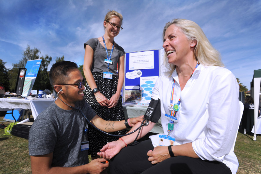 The Oxford Health Charity's Healthfest 2019 at The Warneford Hospital, Oxford.Advanced nurse practitioner JC takes highly specialist occupational therapist Sarah King's blood pressure, watched by clinical physiotherapist Emma Garrett, centre.