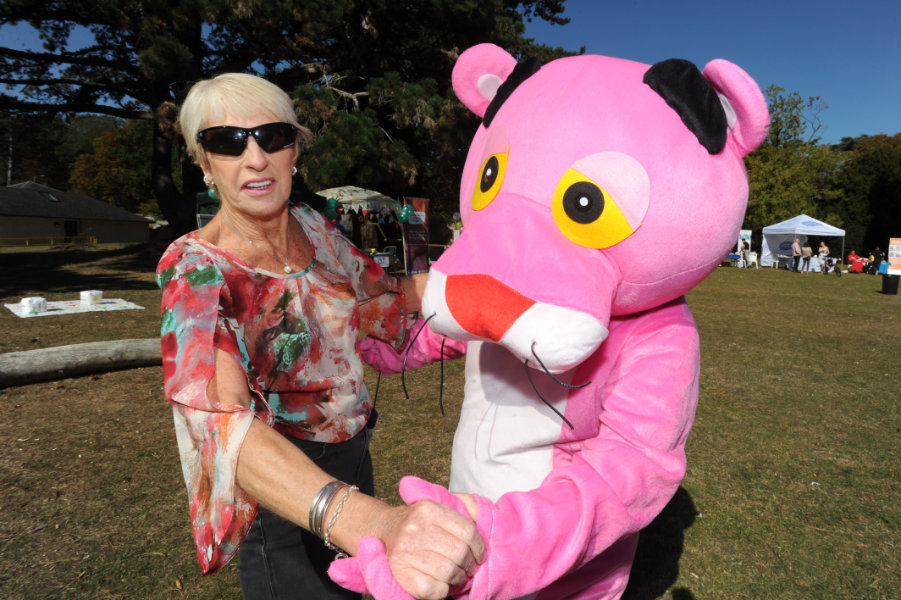 The Oxford Health Charity's Healthfest 2019 at The Warneford Hospital, Oxford. The Pink Panther mascot dancing with Chris Varney.