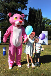 The Oxford Health Charity's Healthfest 2019 at The Warneford Hospital, Oxford. The Pink Panther Mascot with Flo and Nelson Shipp, aged five and two and three-quarters respectively.