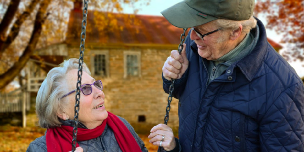 Photo of two older people having a conversation.