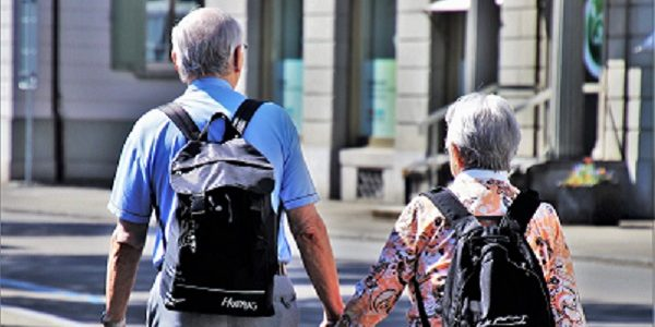 Photo of a carer walking with a service user.