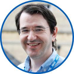 Headshot of board member, Ben Riley