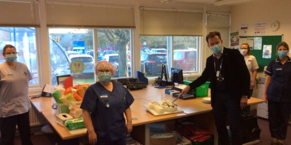 Nick Broughton cuts cake to celebrate hospital at home tenth birthday