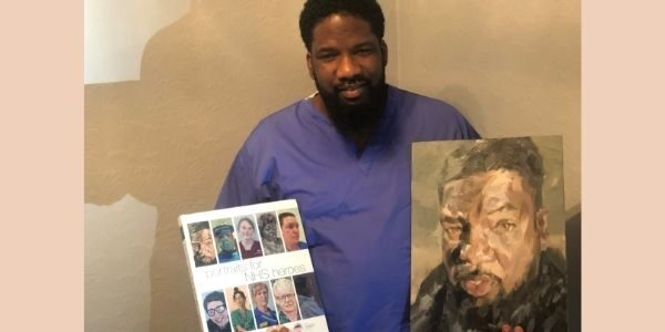 Karl Ellis with with the art book Potraits of NHS Heroes