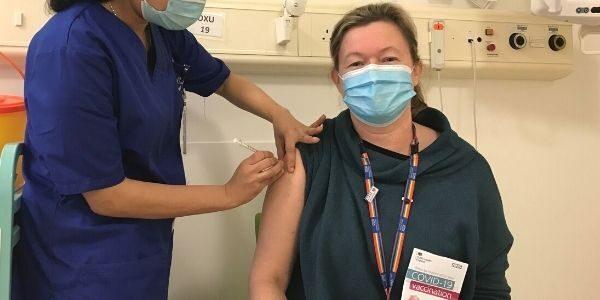 Photo of Rebecca Holder getting the covid vaccine