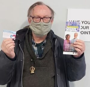 Man with vaccination leaflet