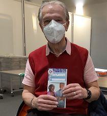 Kassam vaccination recipient with leaflet