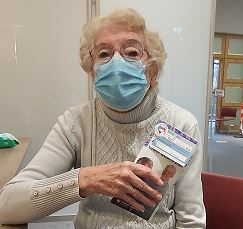 Lady with vaccination leaflet