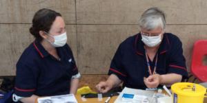 Susan Mahoney and Margaret Batsel at a school vaccination session