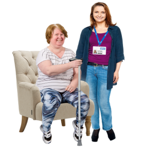 A nurse and patient sitting in an armchair