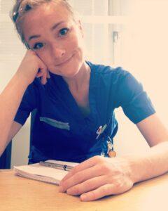 Hannah-Louise Toomey by a desk