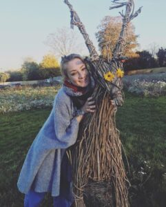 Hannah-Louise Toomey hugging a straw stag