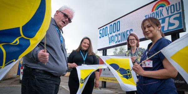 Football team congratulate vaccination squad on 500,000 jabs